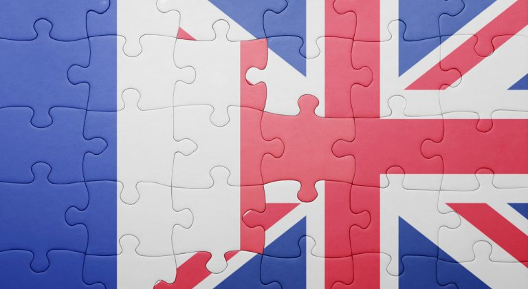 Puzzle with the national flag of great britain and france