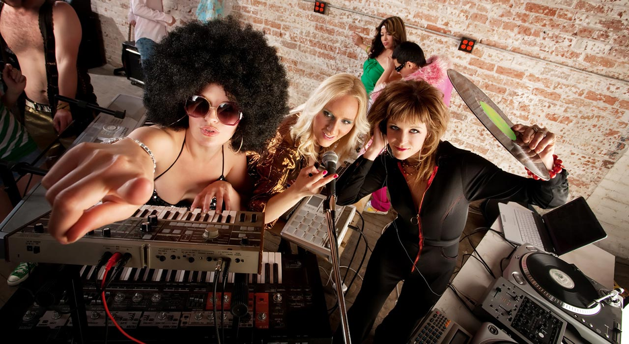 Female DJs checking out the scene at a 1970s Disco Music Party