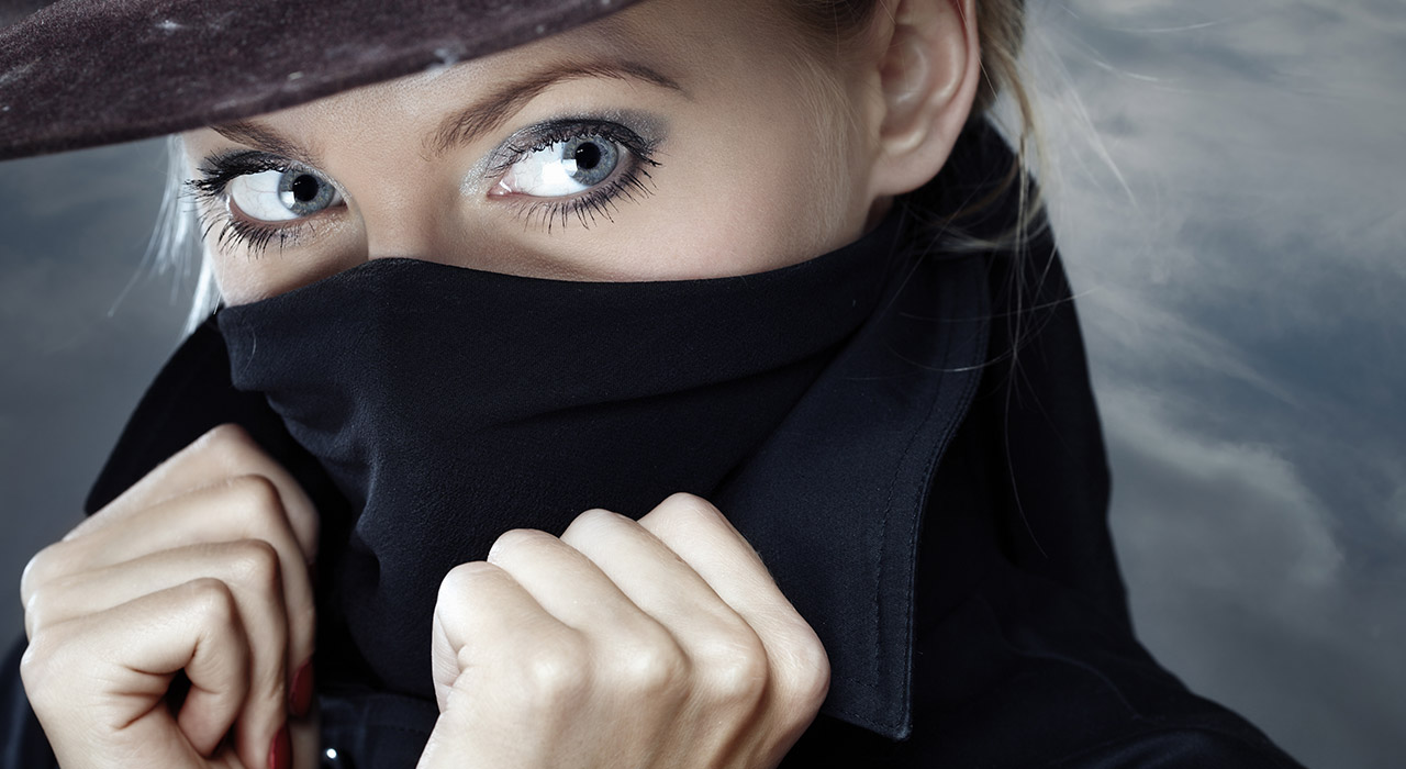 Female spy hides her mouth